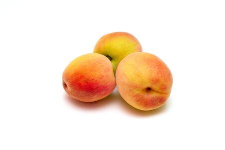 isolated three ripe peaches photo