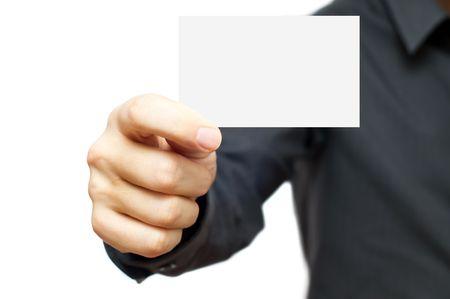 Businessmen in the dark shirt holding blank business card