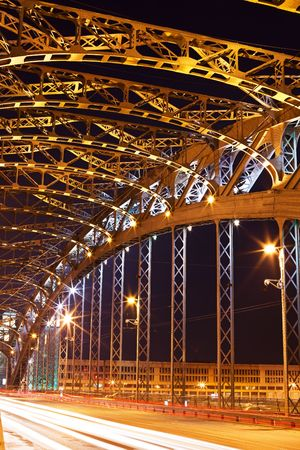 steel arch bridge: steel construction by night. Bolsheohtinskiy bridge in St. Petersburg. Russia