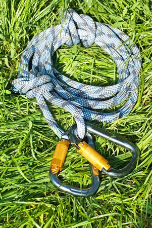 climbing equipment - carabiners and rope on the grass