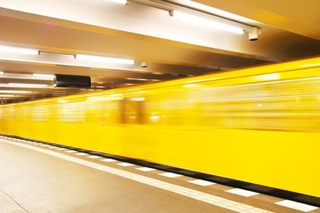 Yellow underground train in motion Standard-Bild
