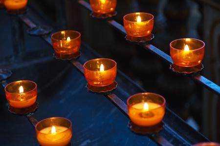 Prayer candles in a church photo