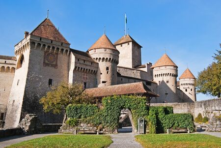 The Chillon Castle (Chateau de Chillon) is located on the shore of Lake Geneva in the municipality of Veytaux, at the eastern end of the lake, 3 km from Montreux, Switzerland. It is the most visited historic monument in Switzerland! photo