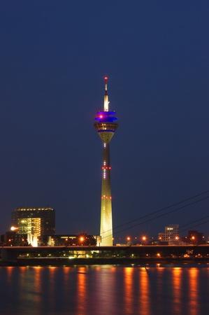 Media Port (Medienhafen) and Rheinturm tower Dusseldorf at night photo