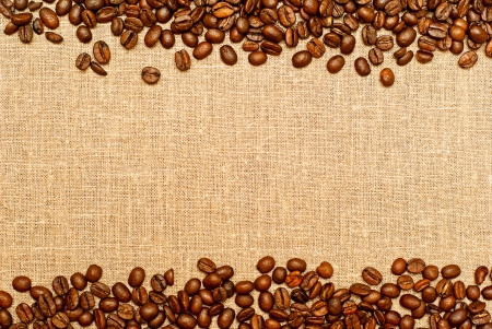 sackcloth: coffee grains on the burlap backgruond with copy space Stock Photo
