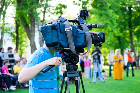The cameraman filming outdoor event Stock Photo - 9409299
