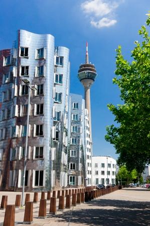 Rheinturm tower and modern buildings in Dusseldorf. Germany Stock Photo