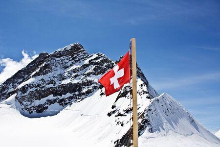 jungfraujoch: Swiss flag agains top of Jungfrau