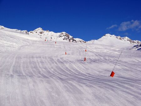 piste: Empty skiing slope early in the morning Stock Photo