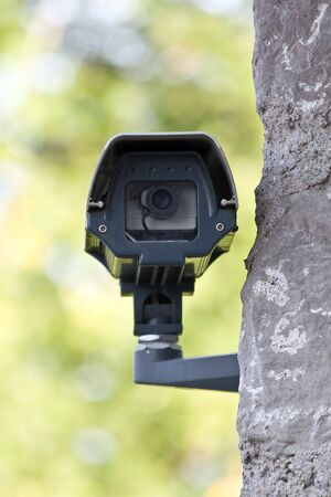 Surveillance camera on the wall Stock Photo - 5066578