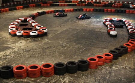Safety berriers made of old wheels in indoor karting hall photo