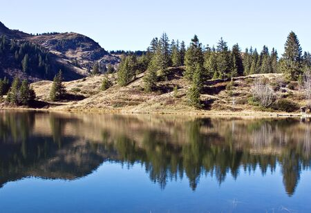 Reflections in the water of mountain lake Stock Photo - 5066819