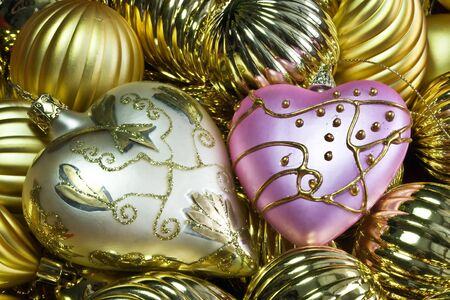 Christmas decorations (two hearts over golden bacjground) Stock Photo - 5067010