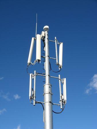 gsm: GSM Antenna against blue sky Stock Photo