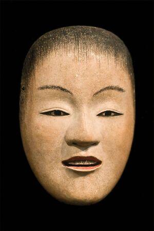 sidelit: Female mask (Japanese Noh theatre)