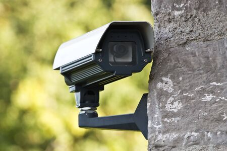 Surveillance camera on the wall photo