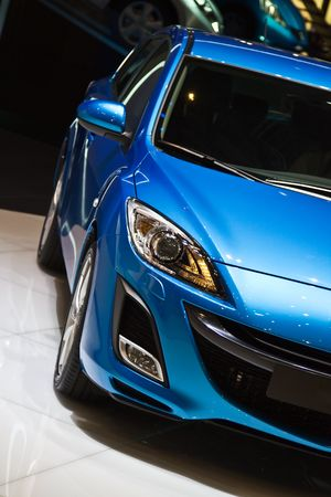 front bumper: Blue car on auto show
