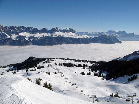 st gallen: Skiing above the clouds in Flumserberg (St. Gallen, Switzerland) Stock Photo