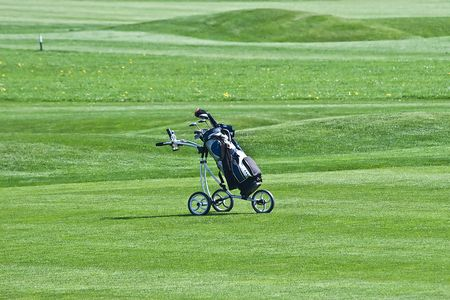 Golf trolley on the grass photo