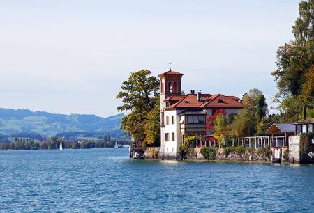Luxury house on the shore of the lake Thun (Switzerland) photo