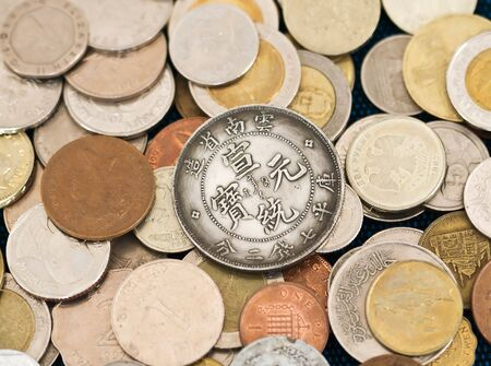 Collection of various coins with chinese coin on the top Stock Photo - 5165001