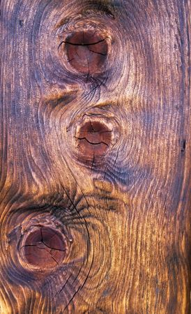 knothole: Closeup of the tarred wooden structure