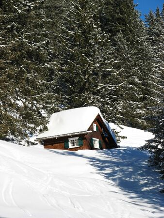 Small house in swiss alps Stock Photo - 5380172