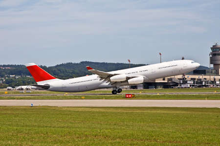 Commercial liner taking off in Zurich Airport photo