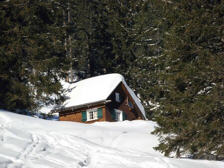 Winter holiday house in swiss alps Stock Photo - 5815092