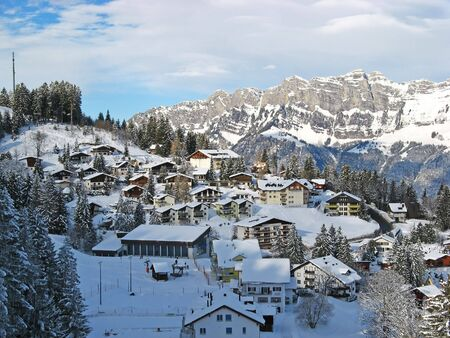 Winter holiday houses in swiss alps photo