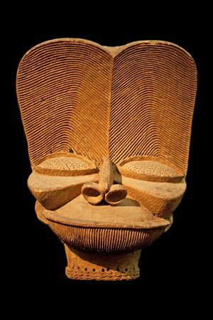 African wooden mask isolated on black photo