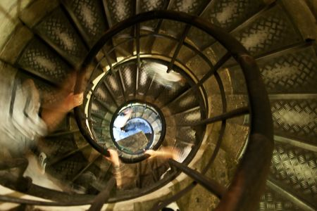 Old spiral stairway inside Arc de Triumph, Paris, France photo