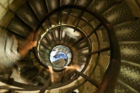Old spiral stairway inside Arc de Triumph, Paris, France photo