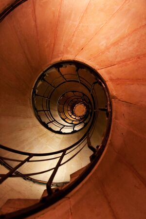 Spiral staircase and stone steps in old tower photo