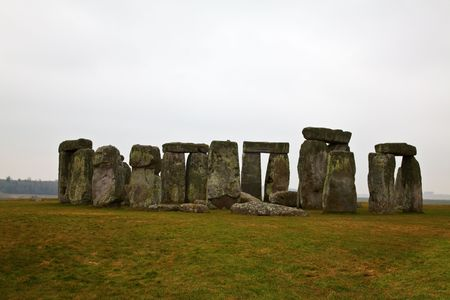 Famous Stonehenge in a foggy winter day photo