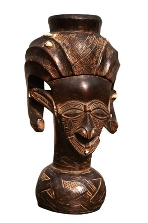 African wooden statue isolated on white photo