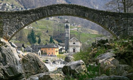 natural arch: Ancient stone arch bridge in Verzasca valley, Switzerland