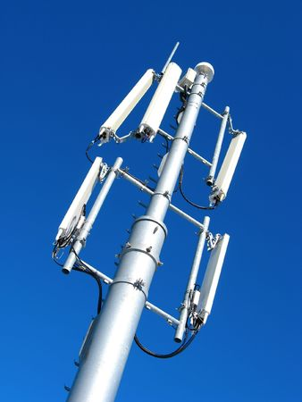 electromagnetic radiation: GSM Antenna against blue sky Stock Photo