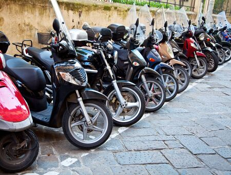 Row of the motorcycles on the old street photo