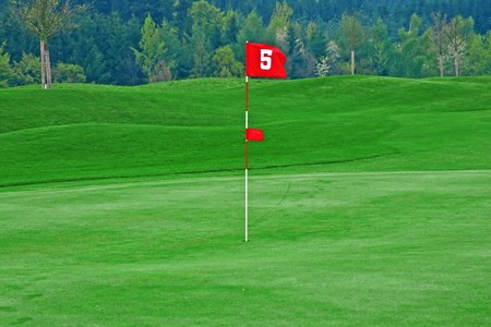 Red flag on the golf course photo