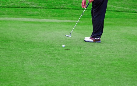 Player finishing the game (putting ball in the hole) photo