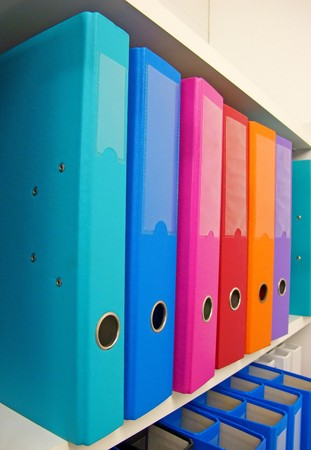 Colorful office folders on the bookshelf Stock Photo - 7160713
