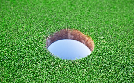 caddie: Golf Hole with shallow depth of field Stock Photo