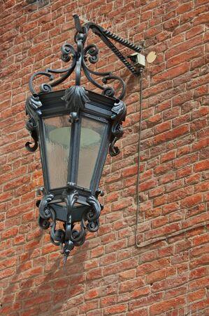 Old iron lantern in Siena, Italy photo