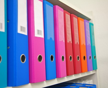 Colorful office folders on the bookshelf Stock Photo - 7303929