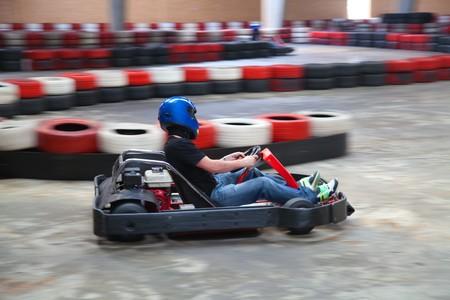 Racing go-kart on indoor track photo