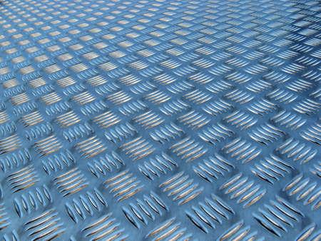 rough diamond: polished metal diamond plate close up