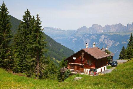 Small farm in the swiss alps photo