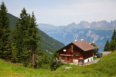 chalet: Small farm in the swiss alps Stock Photo