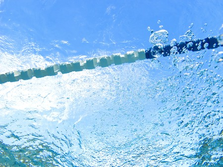 Blue water of the swimming pool photo